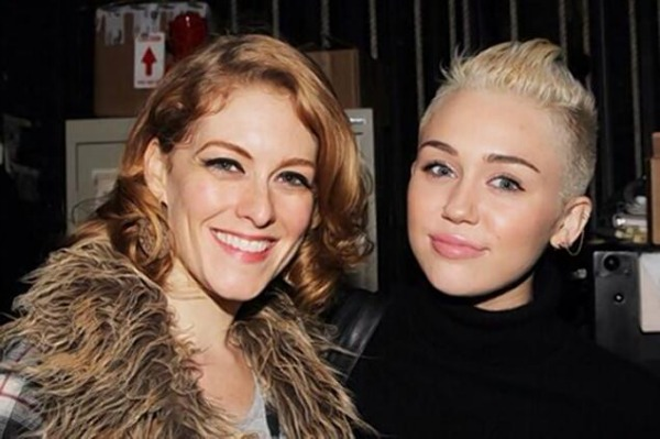 Miley Cyrus and mystery woman