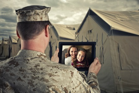 Military family talking on webcam