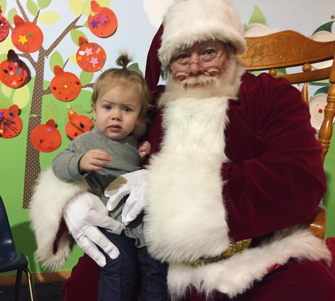 Skeptical child with Santa