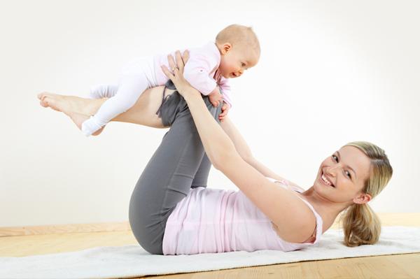 Mom and baby doing yoga