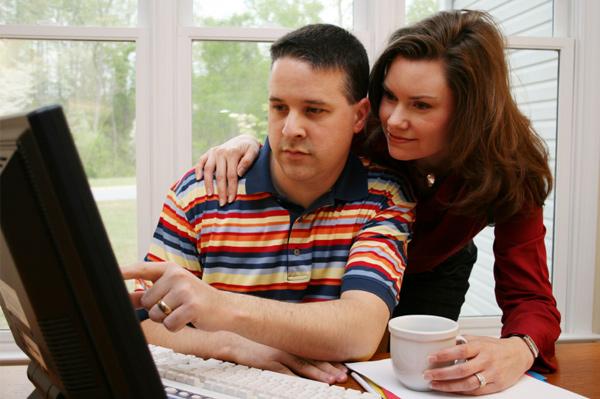 Mom and dad looking at computer