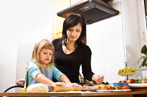 Mom and daughter making homemade pizza