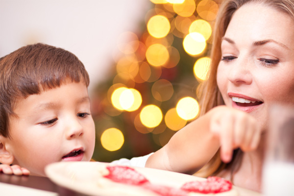 Mom and son with Christmas cookies