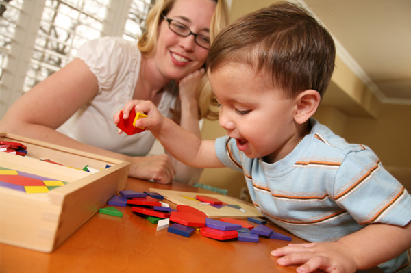 mom and kids playing with blocks