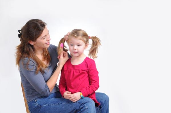 mom-brushing-daughters-hair