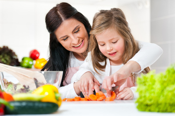 Mother and child cooking in the kitchen