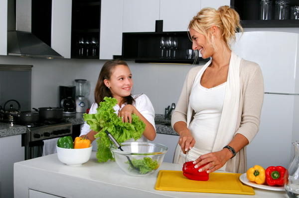 Mom and daughter making salad