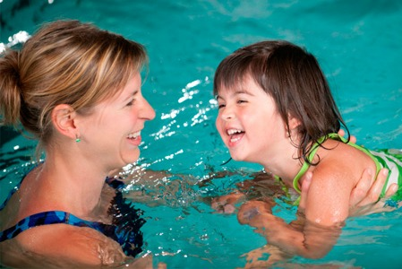 Mother and daughter swimming