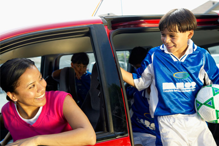 Mom dropping off son at soccer practice