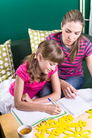 Mom homeschooling daughter