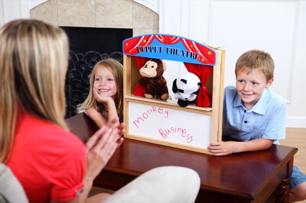 Mom and kids performing puppet show