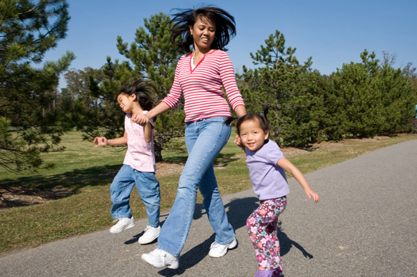 Mom out walking with two girls