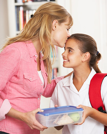mom packing school lunch for daughter