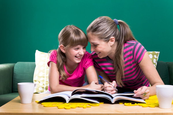 Mom helping daughter with homework
