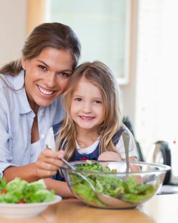 Mom preparing salad