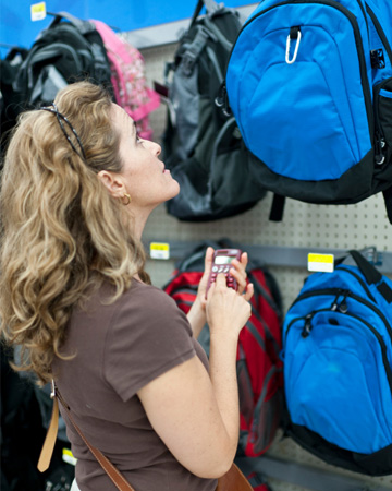 Mom shopping for backpacks