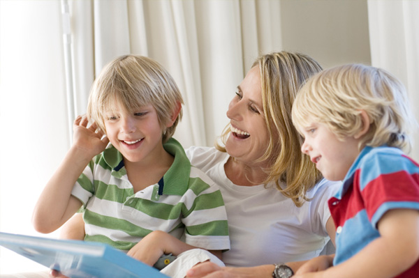 Mom and sons reading a book