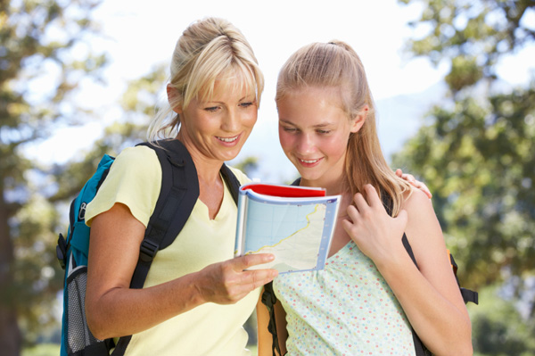Mum and teen daughter hiking