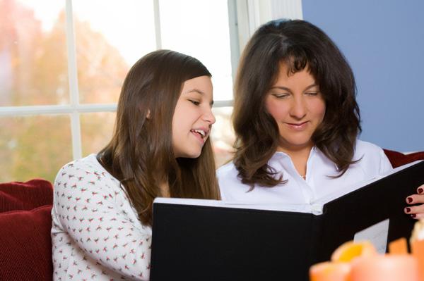 Mom and teen looking at photos