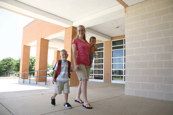 Mom walking son to school