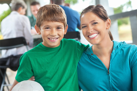 Mom with son at soccer practice