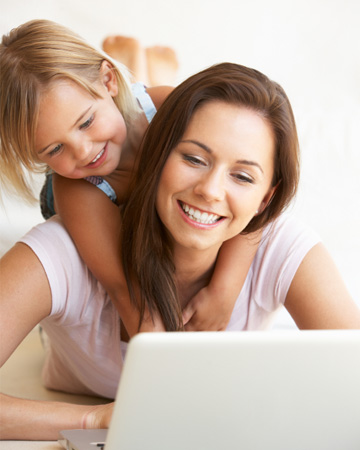 Mom working from home with happy daughter