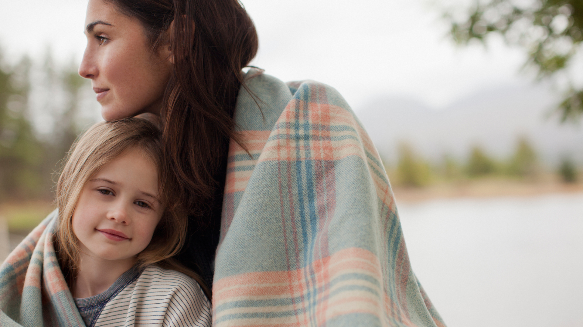 Mother comforting daughter | Sheknows.com