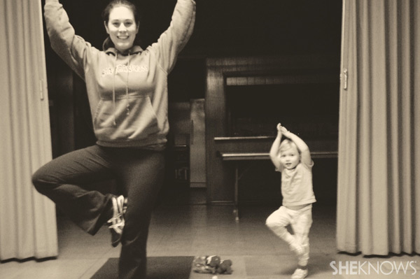 Mother and daughter practicing yoga | Sheknows.com
