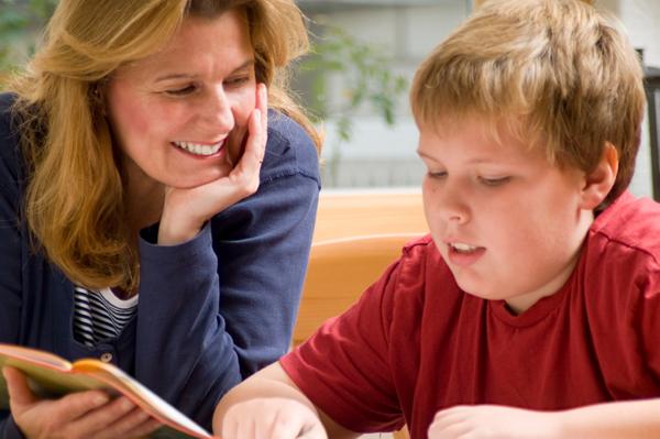 Mother praising son over homework