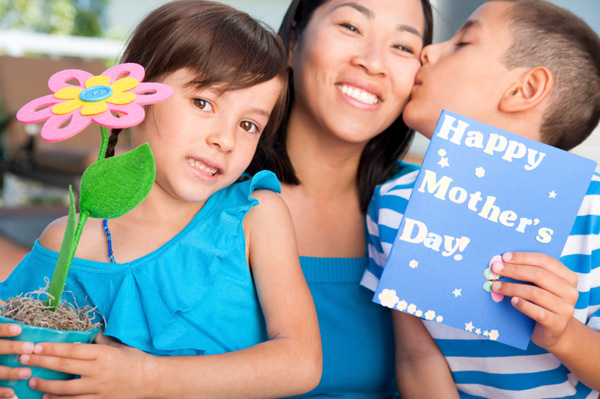 Children giving gifts to mother on Mother's Day