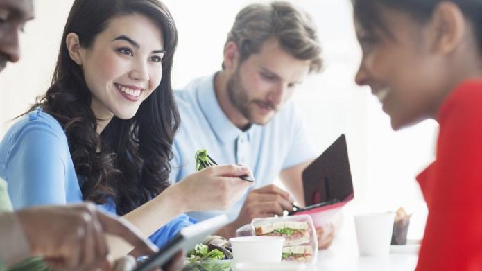 Business people using digital tablet in