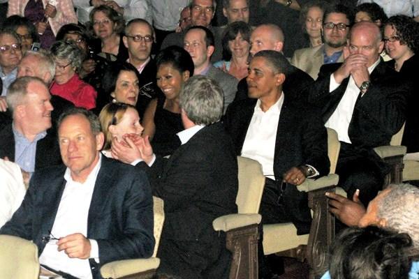 The Obamas take their seats