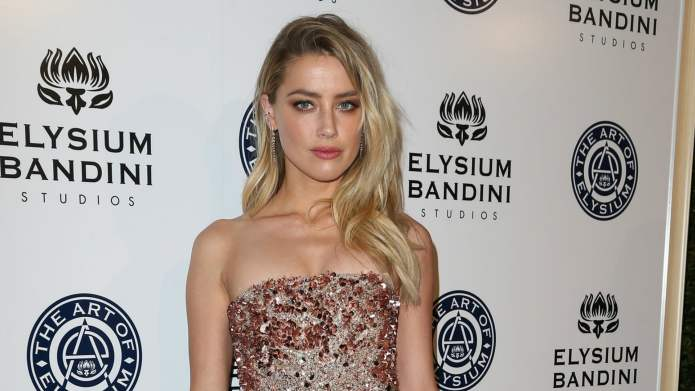 Amber Heard confirms divorce drama with