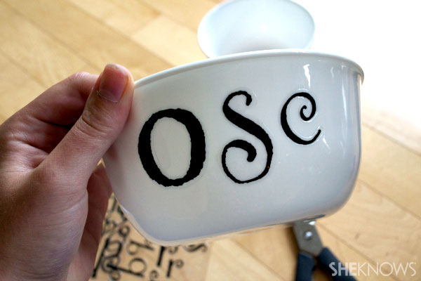 Apply letter stickers to bowl