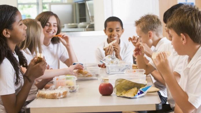 Schoolchildren enjoying their lunch in a