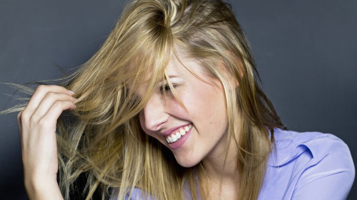 Young woman touching hair
