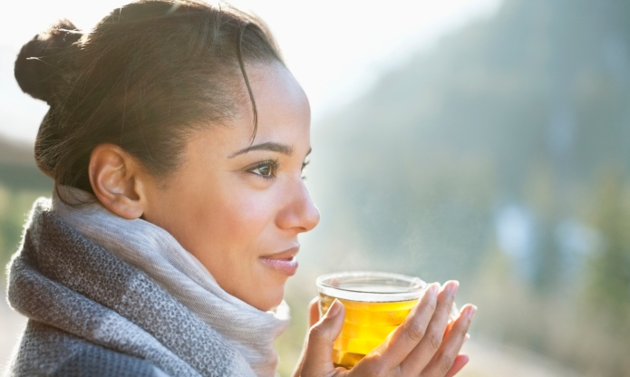 Close up of smiling woman drinking