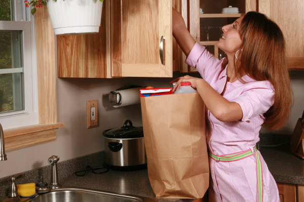 Woman Putting Away Groceries