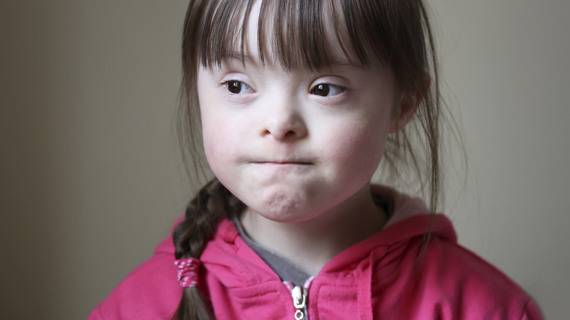 Pensive child with downs syndrome | Sheknows.com