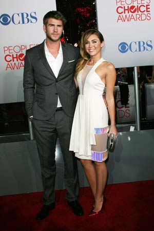 Miley Cyrus and Liam Hemsworth at the People's Choice Awards