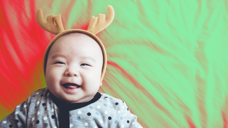 Happy baby in reindeer headband