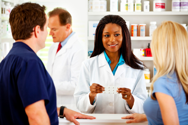 Pharmacist with customers