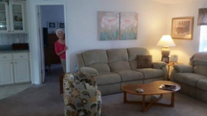 Grandma photobombs home sale photos, becomes