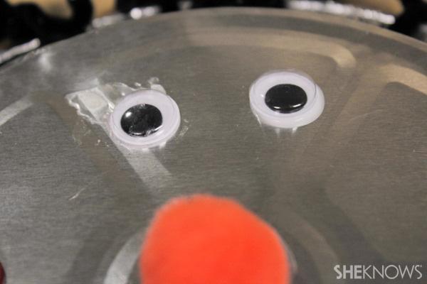 Pie tin robot - add the eyes