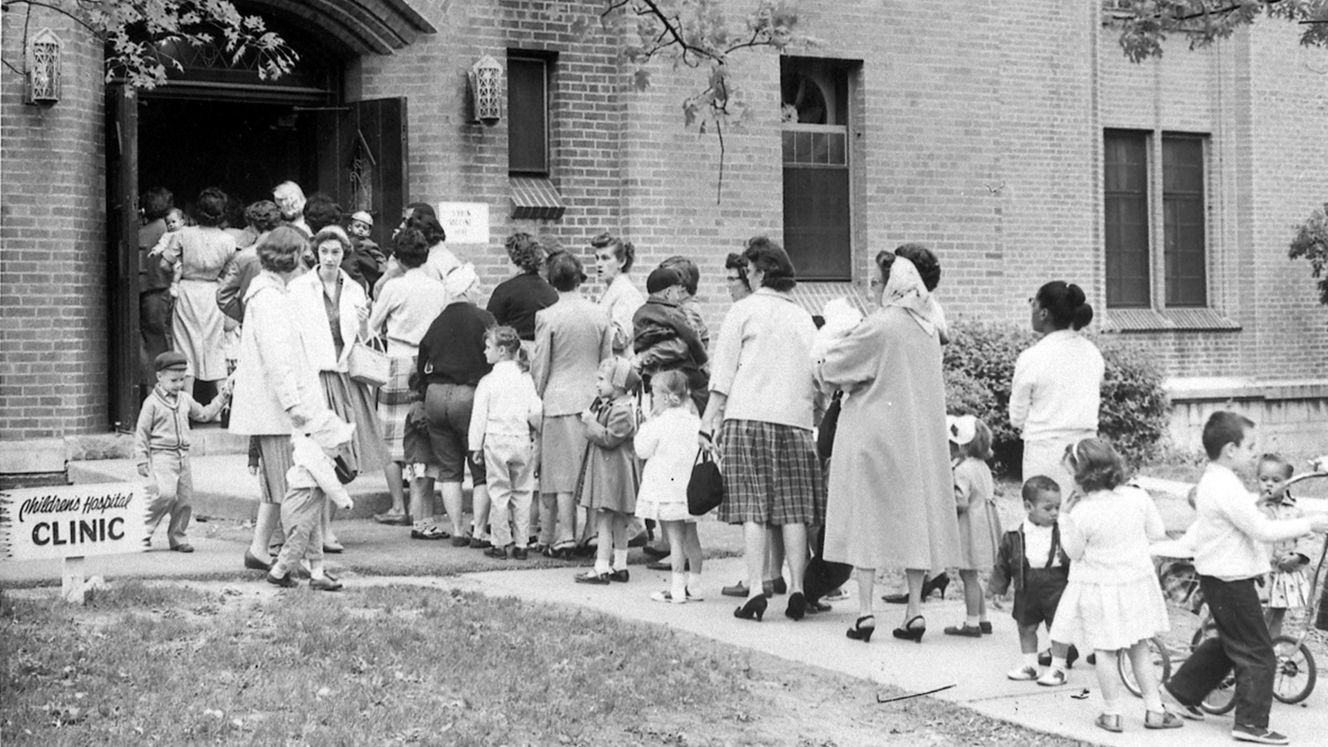 Children and parents line up outside the Children's Hospital in Cincinnati, Ohio to receive polio vaccines in 1960