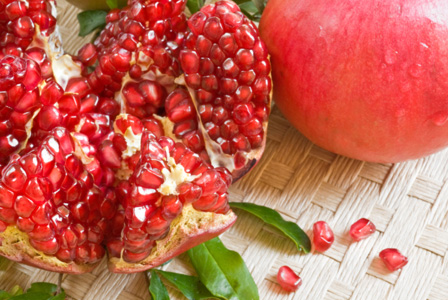 Pomegranate whole and divided