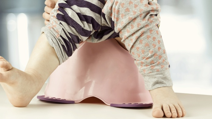 Children's legs hanging down from a