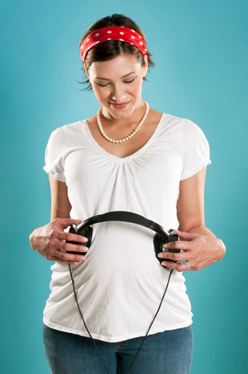 Pregnant Woman with Headphones