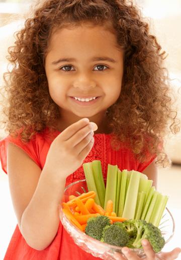 Preschooler eating healthy food