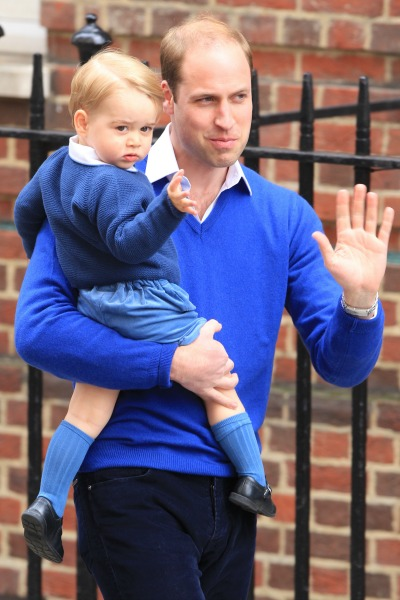 Prince George waving with Prince William